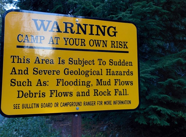 warning sign of severe geological hazards at the entrance to the campground