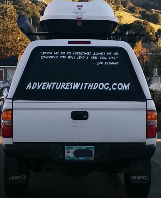 rear of the Tacoma with the plain text URL and Ian Fleming quote on the rear window of the camper shell
