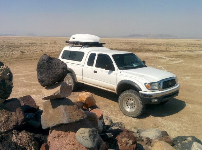 Our rock placed on the pile the Tacoma in the background