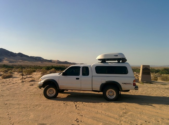 Our Tacoma next to the Camp Cady Historical Marker