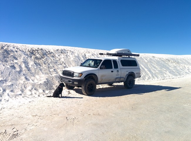 Willow sitting in front of the Tacomaq next to a nice, white sand berm