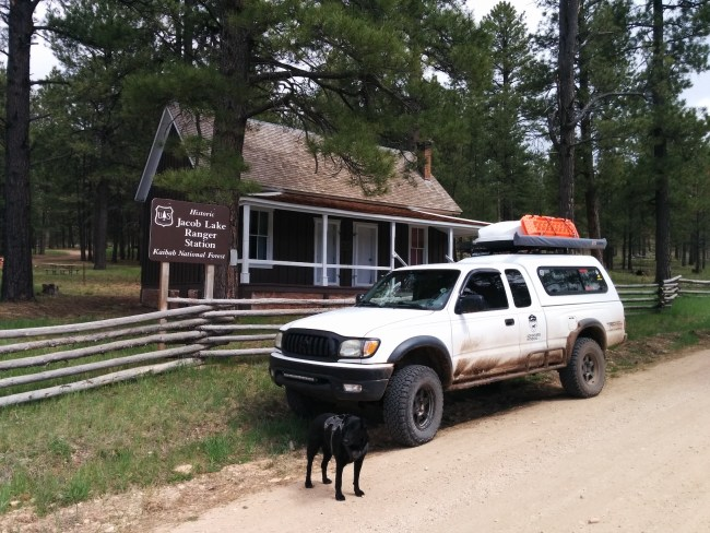 Dog and Tacoma in front of the historic Jacob Lake Ranger Station