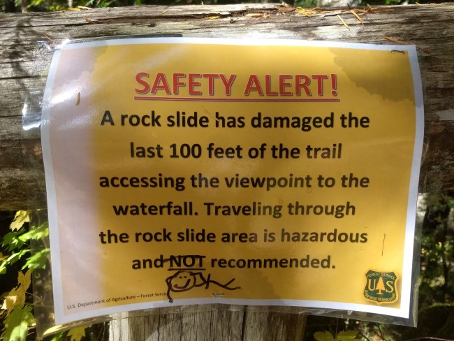 sign saying the trail has been washed out and going past that spot is not recommended