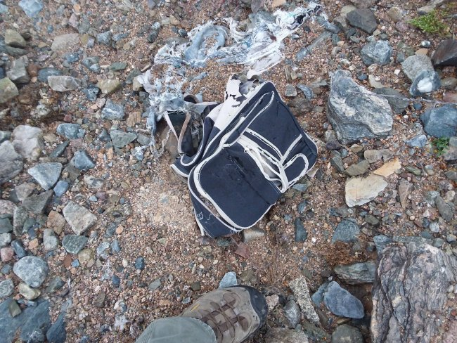 Another different immigrant child's rotting backpack