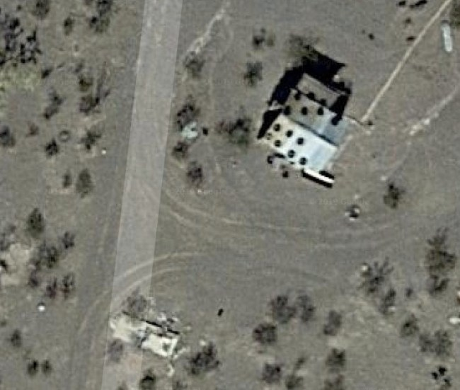 Satellite picture of cabin with roof still on
