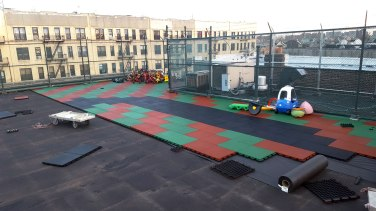 Installing a Rooftop Rubber Playground with Rubber Safety Tiles in Brooklyn, NY | adventureTURF