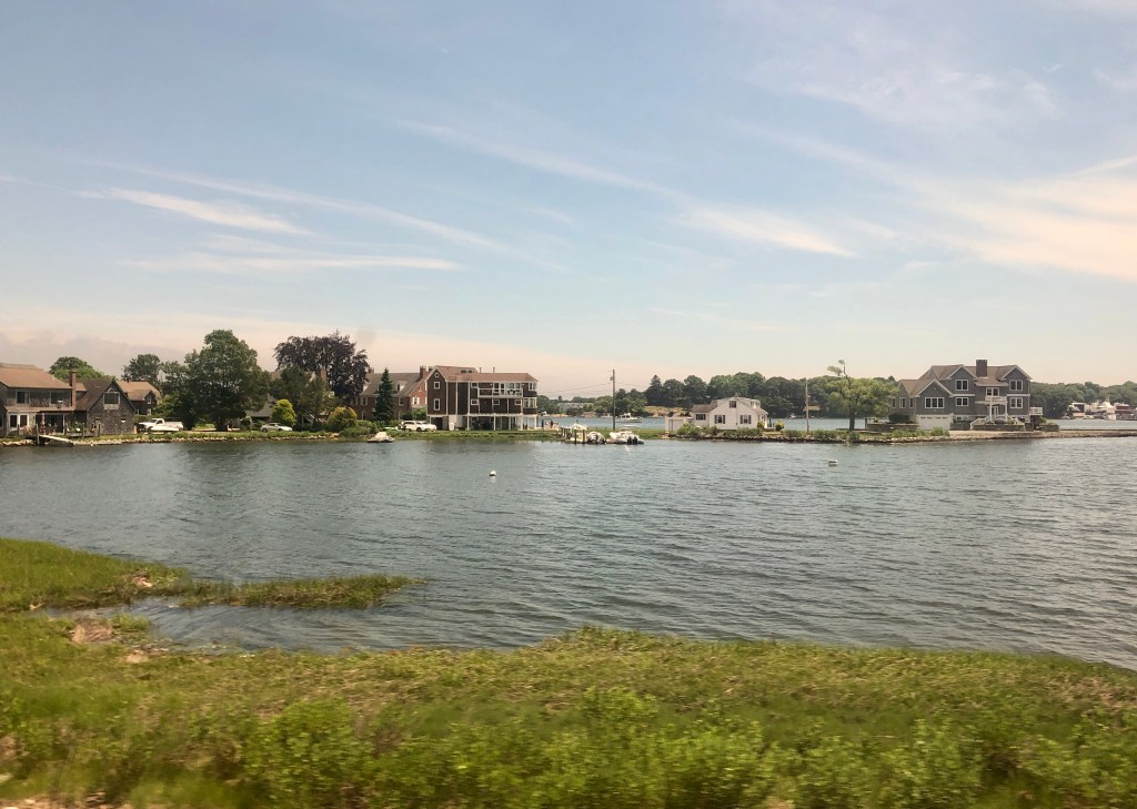 Houses perched on the water on the Connecticut, coastline.