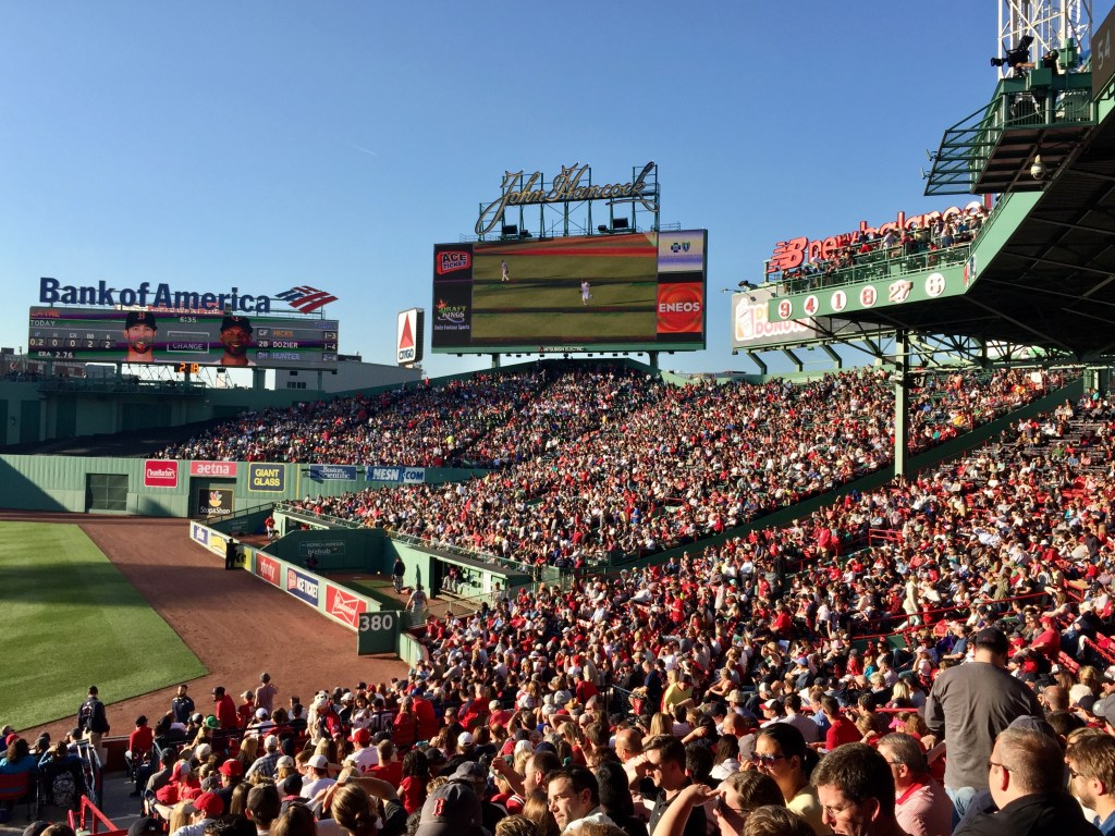 Fenway Park baseball stadium: thousands of people in the stands, many of them wearing red.