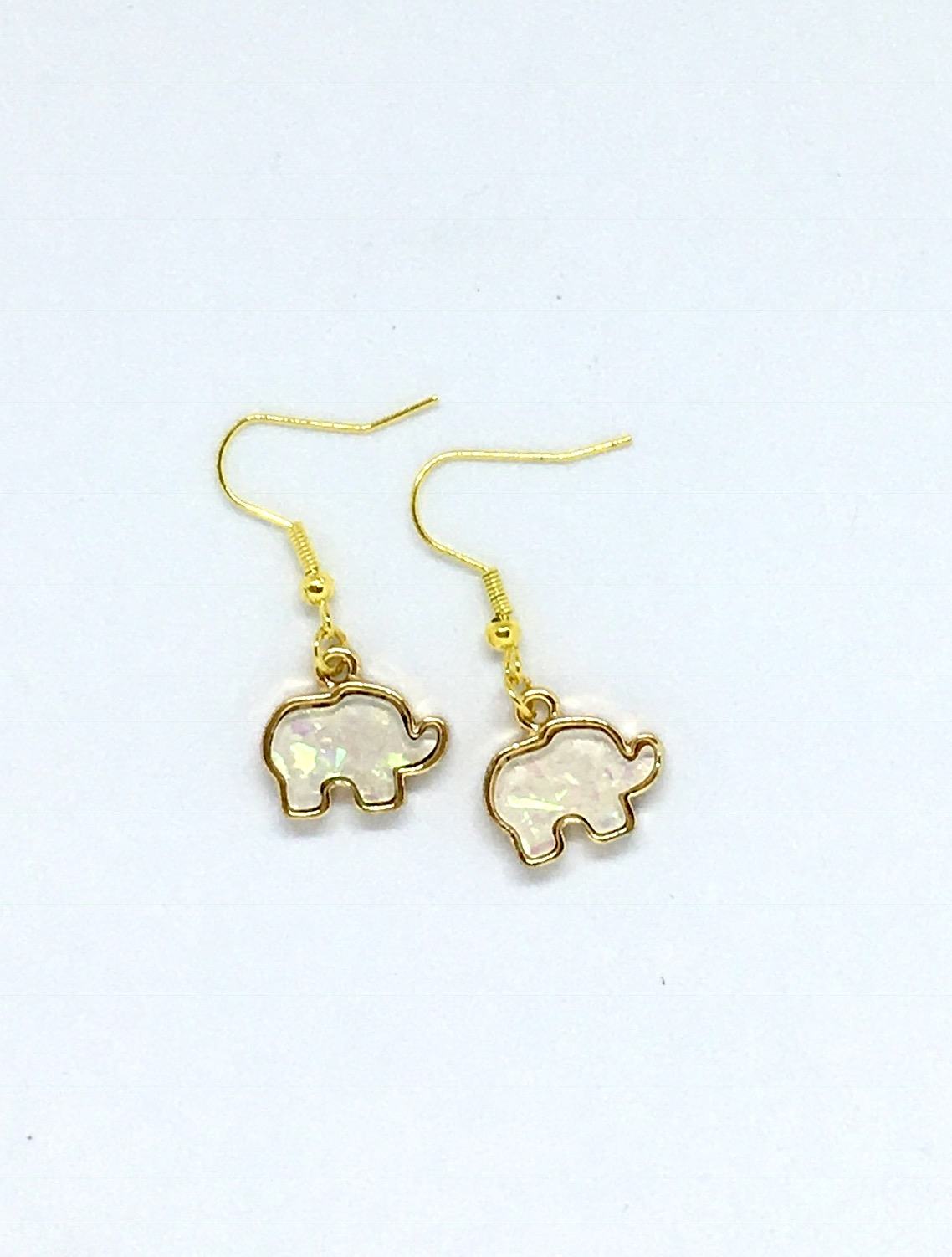 elephant antique white silver background jaebee products jewelry earrings
