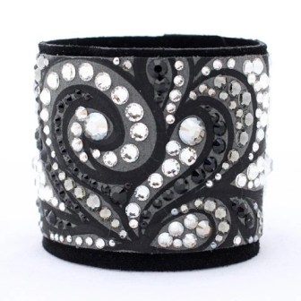 This leather and Swarovski crystal studded cuff by Caroline Rocha is one of a kind and made by hand
