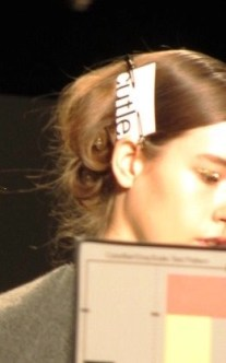 the models kept their hair pinned up until the very last moment