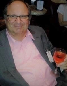 wine columnist John Dunham enjoying a glass of GIFFT wine on the Carnival Splendor
