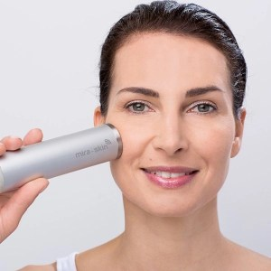 woman using miraskin mira-skin ultrasound device