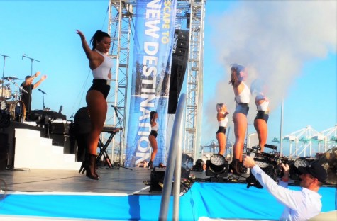 Pitbull and Dancers performing at the Christening ceremony of the NCL ESCAPE