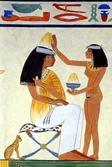 Egyptian woman wearing scented cones. This was normally something meant for men and women of high rank