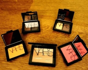 "Man Ray for Nars eye shadow duos & blushes plus a gold ""Double Take"" highlighter embossed with lip design; NARS"