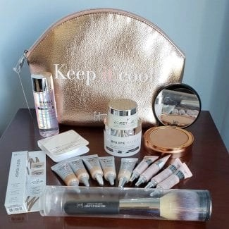 IT itCosmetics makeup bag with all the travel sized mini makeup pand skicnare items keep it cool it cosmetics makeup bag products are inside