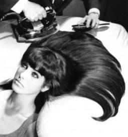using an iron to flatten hair