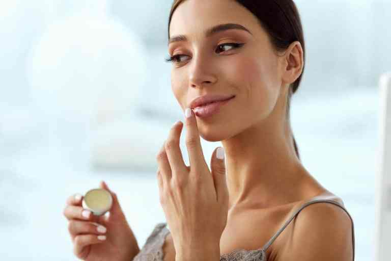 girl applying some lips scrub