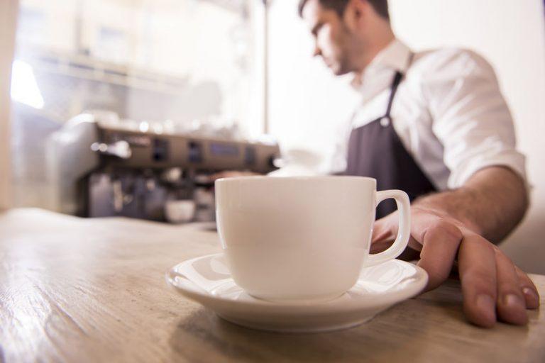 barista serving a coffee