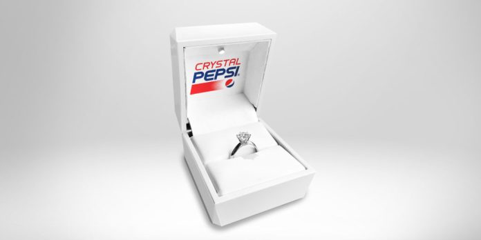 A ring box with a ring that says Crystal Pepsi on the top half of the box