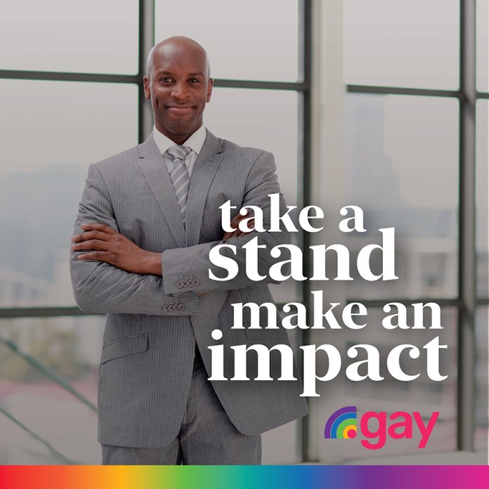 A Black man wearing a grey business suit stands with his