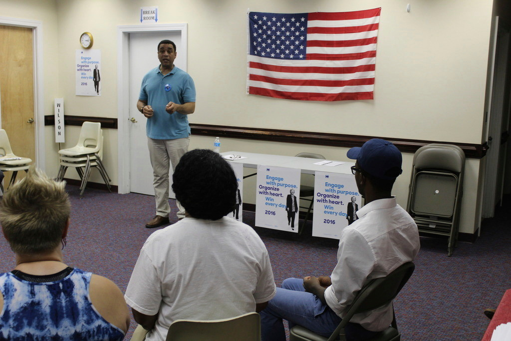 """Wilson County Democratic Party volunteers listen to actor Harry Lennix, co-star of NBC's """"The Blacklist,"""" before beginning a voter registration drive Saturday. Corey Friedman 
