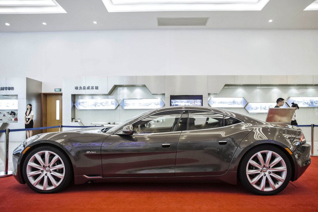 A Karma Automotive LLC Fisker Karma electric sports sedan stands on display in the showroom of Wanxiang Group Corp. in Hangzhou, China, on Saturday, Sept. 3, 2016. Battery makers are expanding production capacity to support rising sales of plug-in vehicles, as China overtook the U.S. to become the world's largest EV market with a tripling in deliveries last year. Photographer: Qilai Shen/Bloomberg