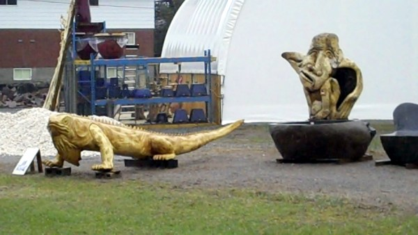 Lizard and Face Sculptures