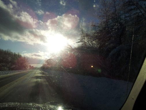 Near prismatic sunburst through jeep window on Bridge Street.