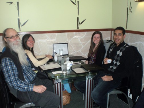 4 people at a table in a restaurant.