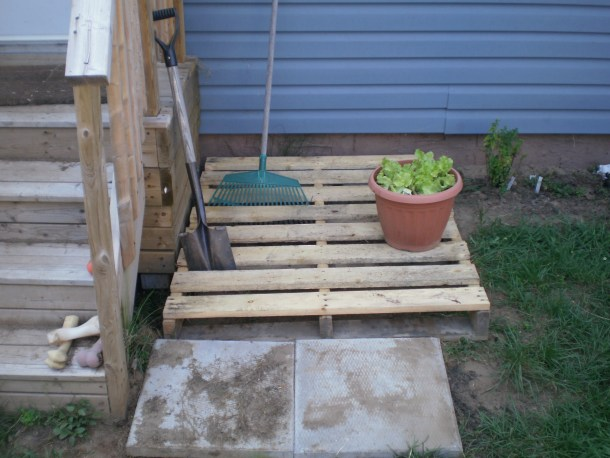 Pallet and patio blocks beside porch steps