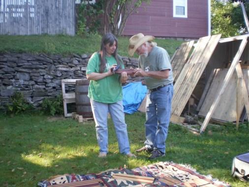 Cathi and Greg admiring Greg's handmade breadboard.