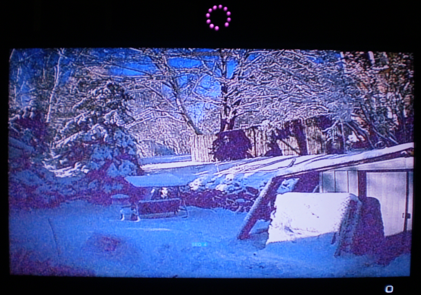 Pretty blue and purple hues through a security camera.