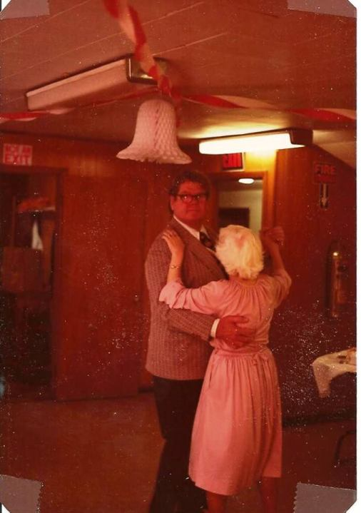 Mom and dad dancing.