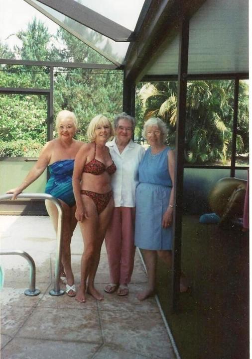 4 women posing for a photo