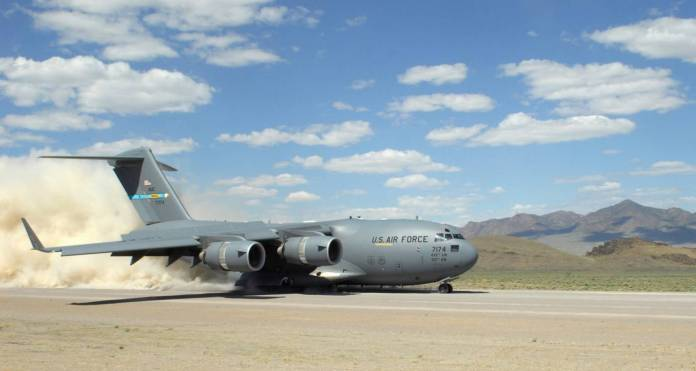 During the short take off and landing phase of the Mobility Air Forces Exercise, a C-17 Globemaster lII ands on a dirt landing zone at the Nevada Test and Training Range at Nellis Air Force Base, Nev.  The 29th Weapons Squadron provides advanced tactical training to C-130 Hercules aircrew selected to attend the Weapons School here. The six-month, graduate-level course culminates in a massive airlift mission, called the Mobility Air Forces Exercise. More than 30 airlift assets and hundreds of support personnel from across the Air Force participate in the biannual training exercise. (U.S. Air Force photo/Staff Sgt. Taylor Worley)