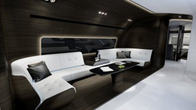 now-for-the-best-room-on-the-vip-plane-the-entertainment-zone-it-comes-with-a-more-roomy-wraparound-couch-and-a-smaller-coffee-table