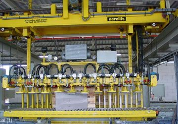 A transfer station using vacuum technology to handle sawn limestone elements