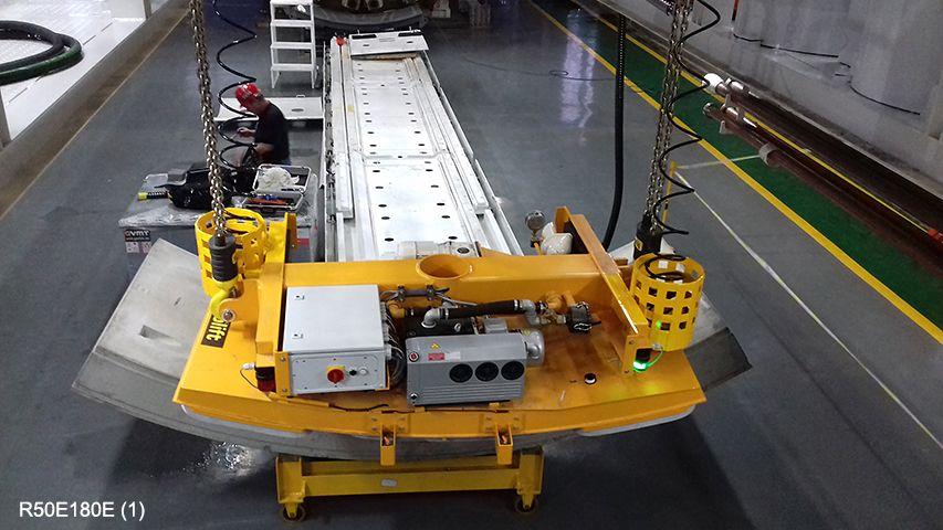 Aerolift vacuum lifter to transport concrete segments to the erector inside a TBM