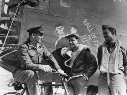 """© Roger Freeman Collection / http://www.americanairmuseum.com - Three airmen of the 93rd Bomb Group stand with the nose art of a B-24 Liberator (serial number 42-40128) nicknamed """"Ball of Fire the III"""" - 93rd Bomb Group Museum"""