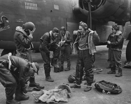 "© Roger Freeman Collection / http://www.americanairmuseum.com - A bomber crew of the 93rd Bomb Group don their flight gear before a mission, flying a B-24 Liberator (41-23717) nicknamed ""Exterminator"". 3 April 1943 - 93rd Bomb Group Museum"