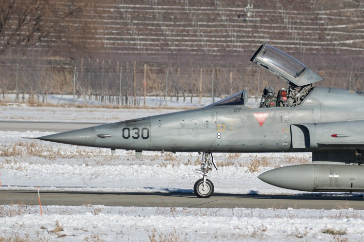 © Adam Duffield - F-5E J-3030 taxis to the active runway with canopy still open - World Economic Forum Air Policing