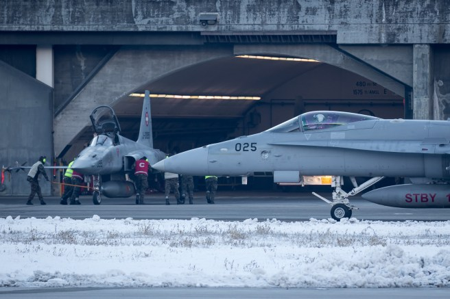 © Adam Duffield - F/A-18C J-5025 taxis past an F-5E outside its HAS - World Economic Forum Air Policing