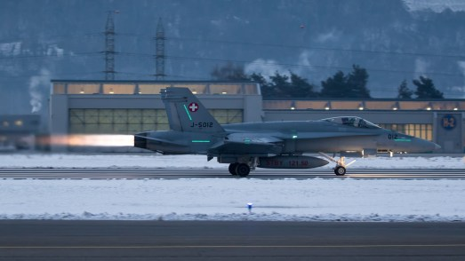 © Adam Duffield - F/A-18C Hornet J-5012 departing early in the morning - World Economic Forum Air Policing