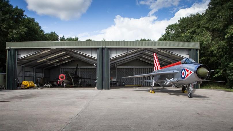 ©Adam Duffield - F3 XR713 outside the ex-RAF Wattisham Q-Shed with F6 XS904 inside - Lightning XR713 56 Sqn scheme unveiling