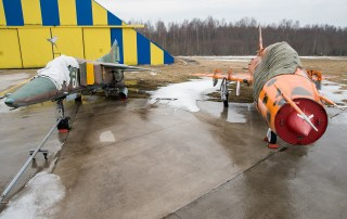 © Duncan Monk - ex-Bulgarian Air Force MiG-23BM White 61 and ex-Polish Air Force Sukhoi SU-22M4 Fitter K '3910' - Jurmala Airport Air Zoo