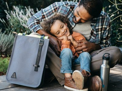father and son on deck with gray Aerrem bag and reusable water bottle