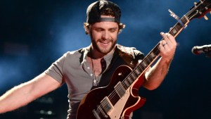 NASHVILLE, TN - JUNE 08: Thomas Rhett performs during the 2014 CMA Festival at LP Field on June 8, 2014 in Nashville, Tennessee. (Photo by C Flanigan/FilmMagic)