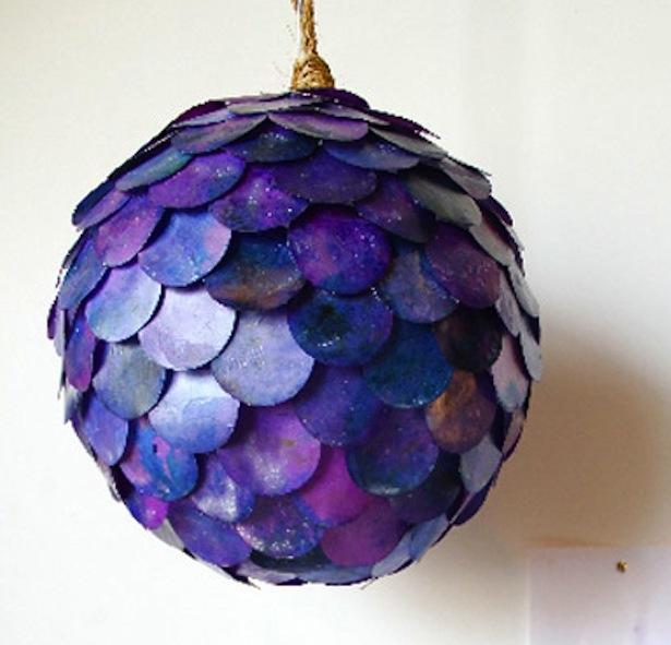 a purple lantern resembling fish scales